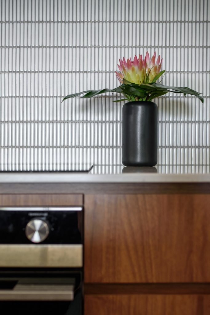 Kitchen renovation featuring white finger mosaic tile splashback