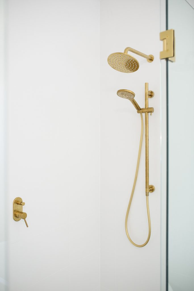 Shower showing gold shower fittings